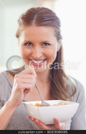 Close up of woman eating cereals stock photo, Close up of young woman eating cereals by Wavebreak Media