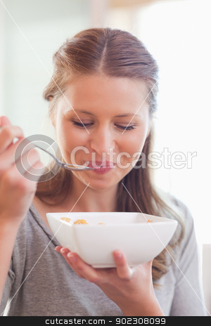 Close up of female eating cereals stock photo, Close up young female eating cereals by Wavebreak Media