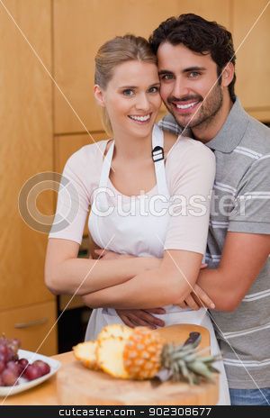 Portrait of a posing with fruits stock photo, Portrait of a posing with fruits in their kitchen by Wavebreak Media