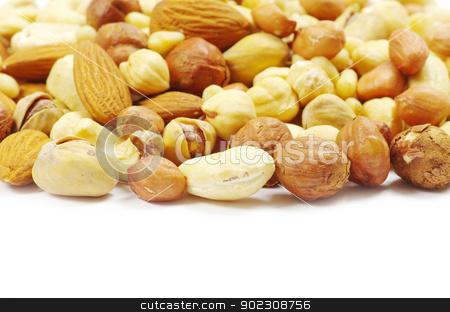 mixed nuts stock photo, Assorted mixed nuts on white background by Vitaliy Pakhnyushchyy