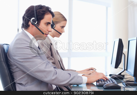 Operators using a computer stock photo, Operators using a computer in a call center by Wavebreak Media