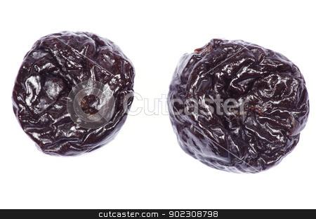 dried plum  stock photo, Dried plum on a white background by Vitaliy Pakhnyushchyy