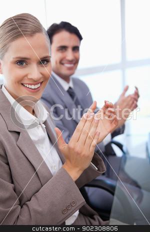 Portrait of a business team applauding stock photo, Portrait of a business team applauding in a meeting room by Wavebreak Media