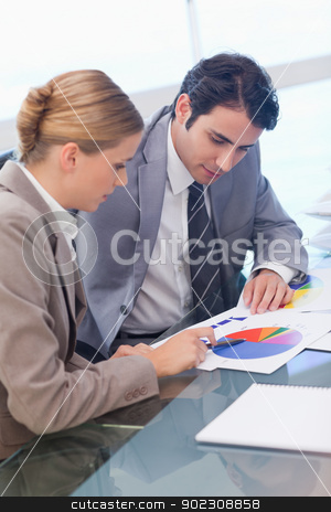 Portrait of business people studying statistics stock photo, Portrait of business people studying statistics in a meeting room by Wavebreak Media