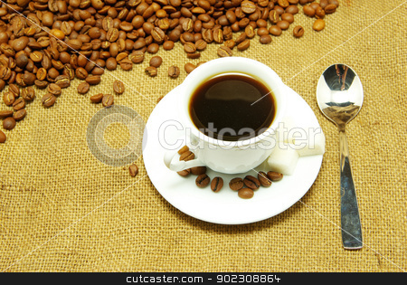 coffee  stock photo, White cup of coffee on beans and sack background by Vitaliy Pakhnyushchyy