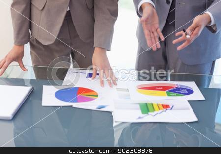 Hands of business people working on statistics stock photo, Hands of business people working on statistics in a meeting room by Wavebreak Media