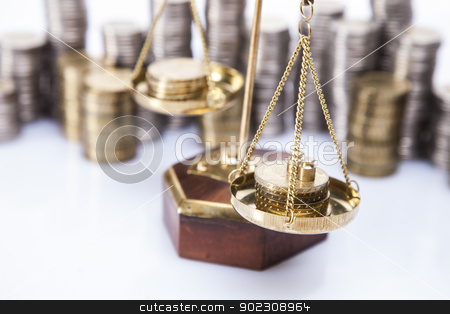 A lot of money! Coins on scales stock photo, A lot of money! Coins on scales by fikmik
