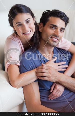 Portrait of a couple posing stock photo, Portrait of a couple posing in their living room by Wavebreak Media