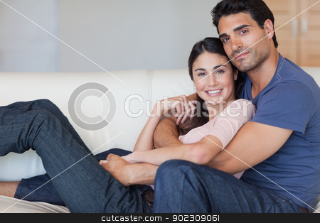 Lovely young couple posing stock photo, Lovely young couple posing in their living room by Wavebreak Media