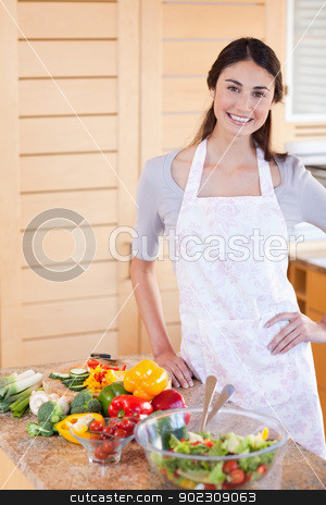 Portrait of a woman standing up stock photo, Portrait of a woman standing up in her kitchen by Wavebreak Media