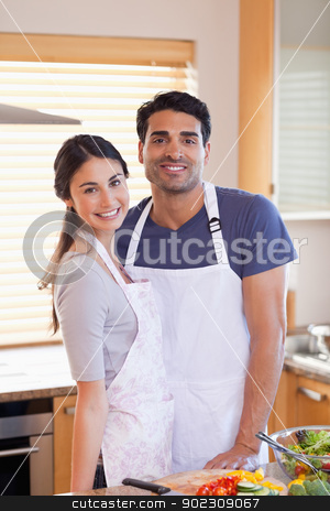 Portrait a couple posing stock photo, Portrait a couple posing in their kitchen by Wavebreak Media