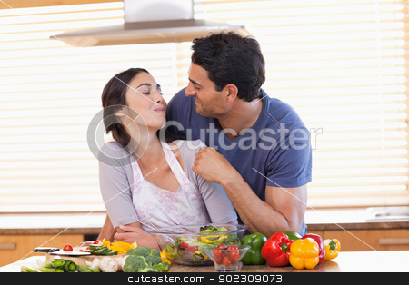 Man feeding his fiance stock photo, Man feeding his fiance in their kitchen by Wavebreak Media