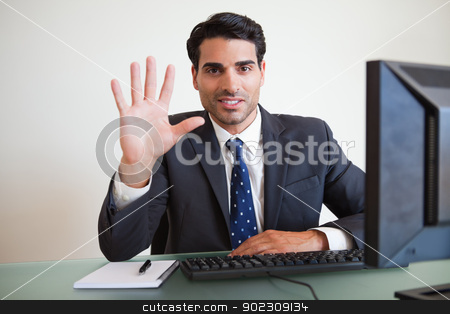 Businessman showing his hand stock photo, Businessman showing his hand in hos office by Wavebreak Media