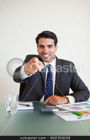 Portrait of a angry businessman pointing at the viewer stock photo, Portrait of a angry businessman pointing at the viewer in his office by Wavebreak Media