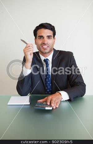 Portrait of a businessman working stock photo, Portrait of a businessman working in his office by Wavebreak Media