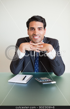Portrait of an accountant posing stock photo, Portrait of an accountant posing in his office by Wavebreak Media