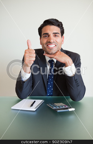 Portrait of an accountant with the thumb up stock photo, Portrait of an accountant with the thumb up in his office by Wavebreak Media