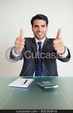Portrait of an accountant with the thumbs up stock photo, Portrait of an accountant with the thumbs up in his office by Wavebreak Media