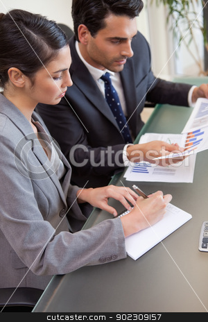 Portrait of sales persons studying statistics stock photo, Portrait of sales persons studying statistics in a meeting room by Wavebreak Media