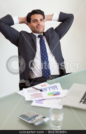 Portrait of a satisfied sales person stock photo, Portrait of a satisfied sales person in his office by Wavebreak Media