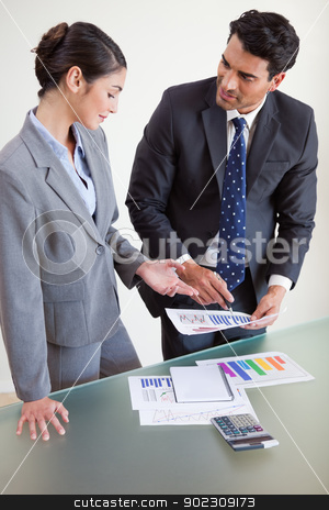 Portrait of sales persons studying their results stock photo, Portrait of sales persons studying their results in an office by Wavebreak Media