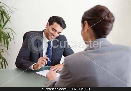 Manager interviewing a female applicant stock photo, Manager interviewing a female applicant in his office by Wavebreak Media