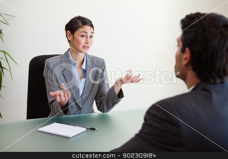 Manager interviewing an employee stock photo, Manager interviewing an employee in her office by Wavebreak Media