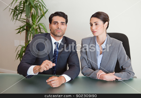 Business team negotiating stock photo, Business team negotiating in a meeting room by Wavebreak Media