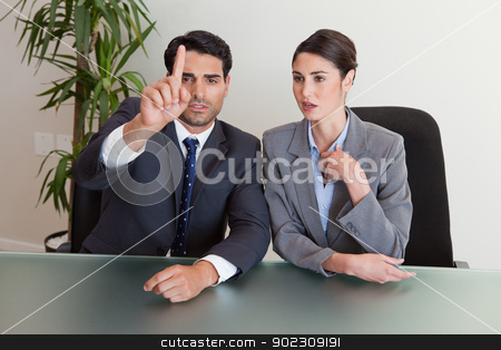 Young business people negotiating stock photo, Young business people negotiating in a meeting room by Wavebreak Media