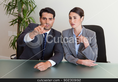 Business people negotiating stock photo, Business people negotiating in a meeting room by Wavebreak Media