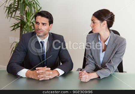 Focused business people negotiating stock photo, Focused business people negotiating in a meeting room by Wavebreak Media