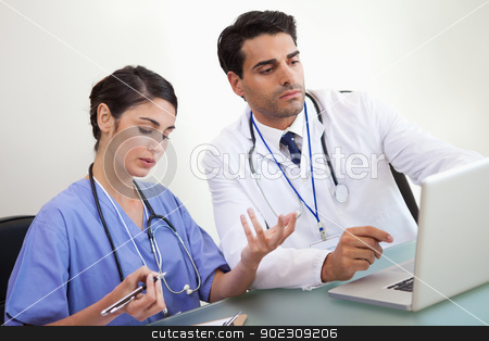 Doctors working with a laptop stock photo, Doctors working with a laptop in an office by Wavebreak Media