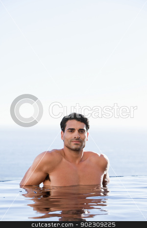 Portrait of a man relaxing stock photo, Portrait of a man relaxing in a swimming pool by Wavebreak Media