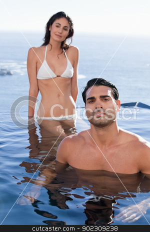Portrait of a smiling couple relaxing stock photo, Portrait of a smiling couple relaxing in a swimming pool by Wavebreak Media