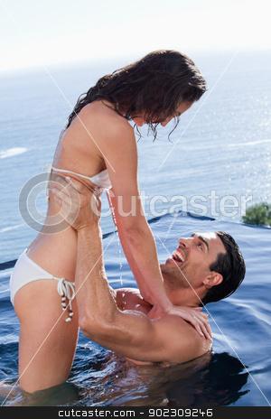 Portrait of a joyful couple relaxing stock photo, Portrait of a joyful couple relaxing in a swimming pool by Wavebreak Media