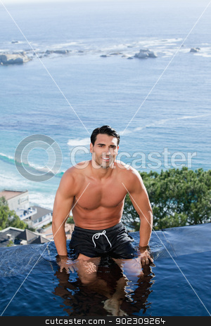 Portrait of a smiling man relaxing stock photo, Portrait of a smiling man relaxing in a swimming pool by Wavebreak Media
