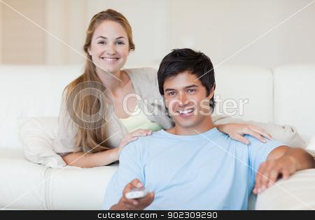Couple watching television stock photo, Couple watching television in their living room by Wavebreak Media