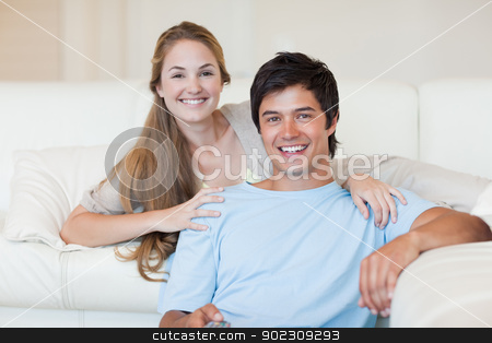 Smiling couple watching television stock photo, Smiling couple watching television in their living room by Wavebreak Media