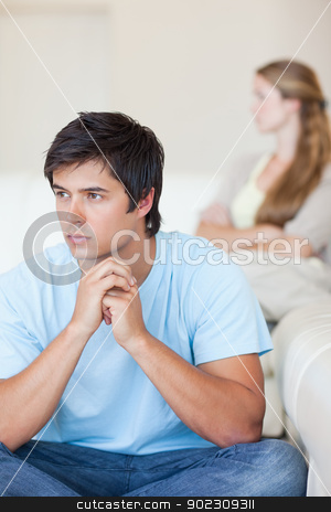 Portrait of an upset couple after an argument stock photo, Portrait of an upset couple after an argument in their living room by Wavebreak Media