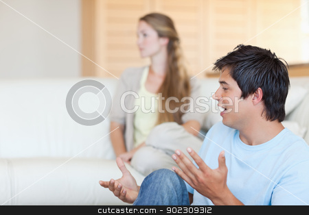 Young couple arguing stock photo, Young couple arguing in their living room by Wavebreak Media