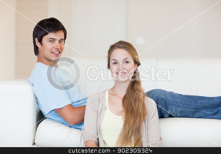 Young couple posing stock photo, Young couple posing in their living room by Wavebreak Media