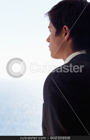Portrait of a businessman day dreaming stock photo, Portrait of a businessman day dreaming while looking at the sea by Wavebreak Media