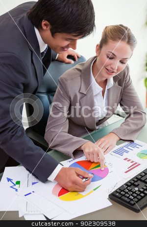 Portrait of a business team studying statistics stock photo, Portrait of a business team studying statistics in a meeting room by Wavebreak Media