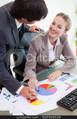 Portrait of a young business team studying statistics stock photo, Portrait of a young business team studying statistics in a meeting room by Wavebreak Media