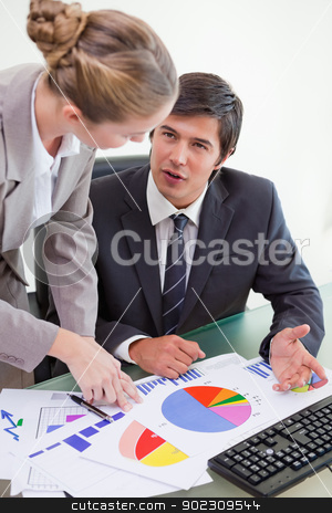 Portrait of a business team studying statistics with a computer stock photo, Portrait of a business team studying statistics with a computer in a meeting room by Wavebreak Media