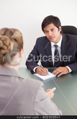Portrait of a young manager interviewing a female applicant stock photo, Portrait of a young manager interviewing a female applicant in his office by Wavebreak Media