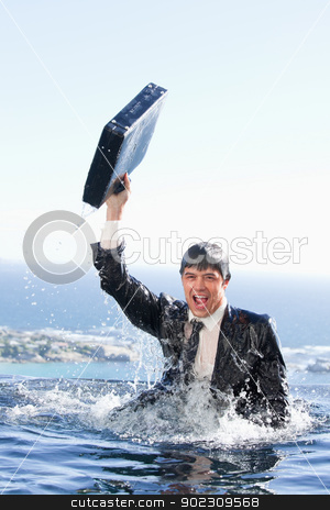 Portrait of a young businessman going out of the water with a br stock photo, Portrait of a young businessman going out of the water with a briefcase in a swimming pool by Wavebreak Media