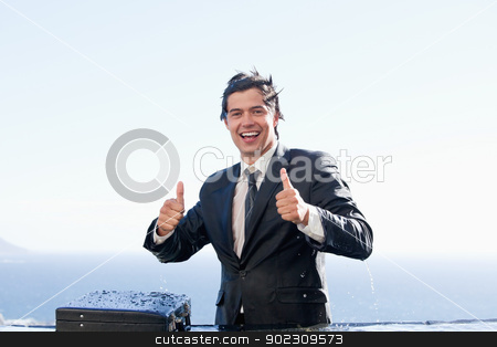 Businessman with the thumbs up stock photo, Businessman with the thumbs up in a swimming pool by Wavebreak Media