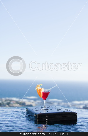 Portrait of a cocktail on a briefcase stock photo, Portrait of a cocktail on a briefcase in a swimming pool by Wavebreak Media