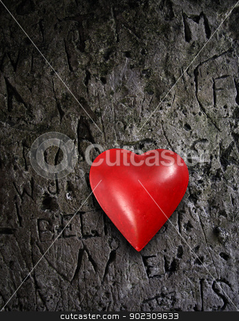 Metal heart on grunge wall stock photo, Photo of a metal heart on a damaged stone wall.   by © Ron Sumners